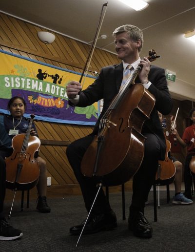 PM enjoying a cello lesson